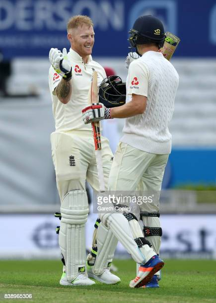 Ben Stokes of England celebrates with Chris Woakes after reaching his century during day one of the 2nd Investec Test between England and the West...