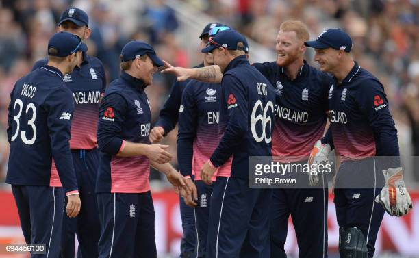 Ben Stokes of England celebrates with Eoin Morgan after the dismissal of Aaron Finch of Australia during the ICC Champions Trophy match between...