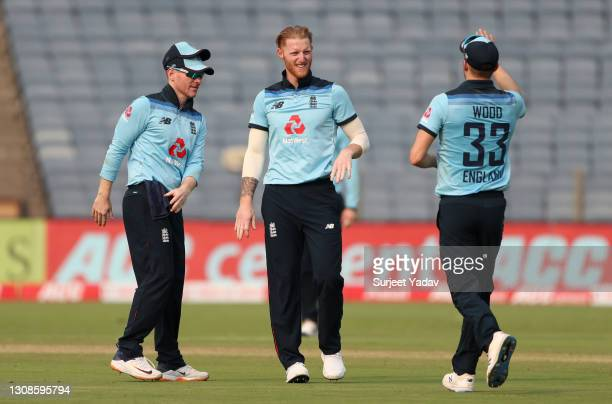 Ben Stokes of England celebrates with Eoin Morgan and Mark Wood after dismissing Shikhar Dhawan of India during 1st One Day International between...