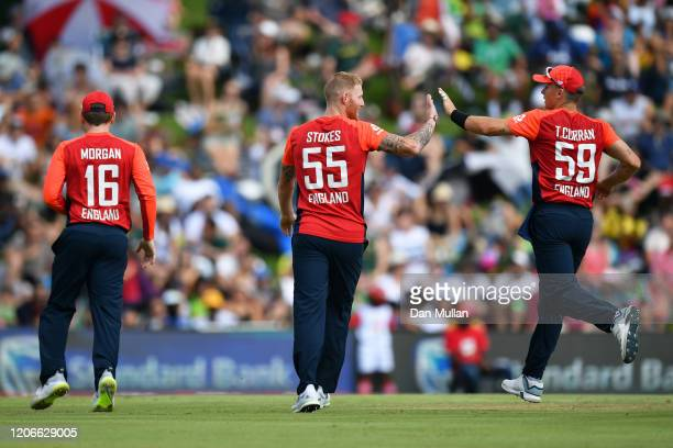 Ben Stokes of England celebrates with Eoin Morgan and Tom Curran of England after dismissing Quinton de Kock of South Africa during the Third T20...