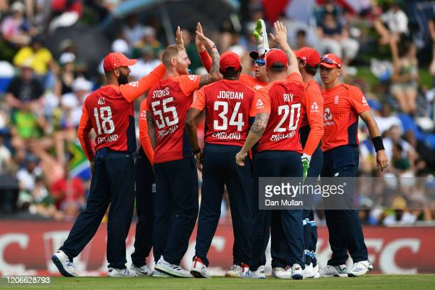 Ben Stokes of England celebrates with his teammates after dismissing Quinton de Kock of South Africa during the Third T20 International match between...