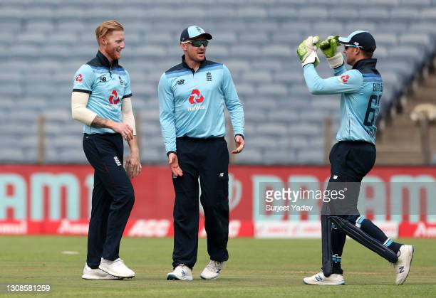 Ben Stokes of England celebrates with Jason Roy and Jos Buttler after dismissing Rohit Sharma of India during 1st One Day International between India...
