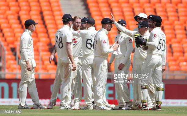 Ben Stokes of England celebrates with Joe Root and teammates after dismissing Rohit Sharma of India during Day Two of the 4th Test Match between...