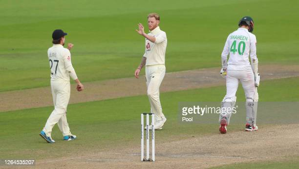 Ben Stokes of England celebrates with Rory Burns after taking the wicket of Shaheen Afridi of Pakistan during Day Three of the 1st #RaiseTheBat Test...