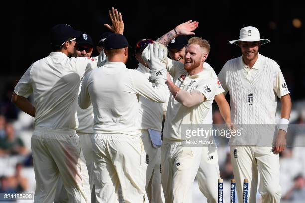 Ben Stokes of England celebrates with team mates after dismissing Quinto de Kock of South Africa during Day Four of the 3rd Investec Test between...