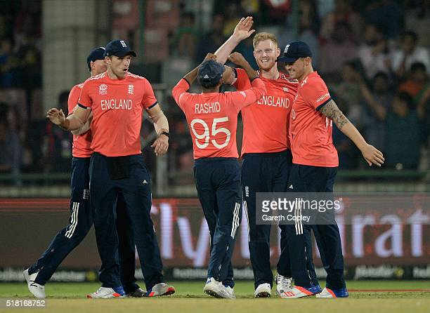 Ben Stokes of England celebrates with teammates after dismissing Corey Anderson of New Zealand during the ICC World Twenty20 India 2016 Semi Final...