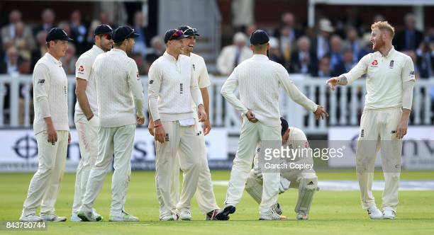 Ben Stokes of England celebrates with teammates after dismissing Roston Chase of the West Indies during day one of the 3rd Investec Test match...