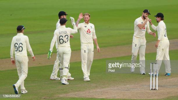 Ben Stokes of England celebrates with teammates after taking the wicket of Shaheen Afridi of Pakistan during Day Three of the 1st #RaiseTheBat Test...