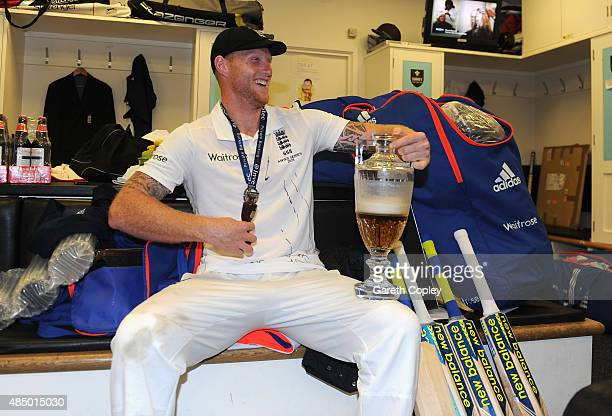 Ben Stokes of England celebrates with the ashes urn in the dressing rooms after the 5th Investec Ashes Test match between England and Australia at...