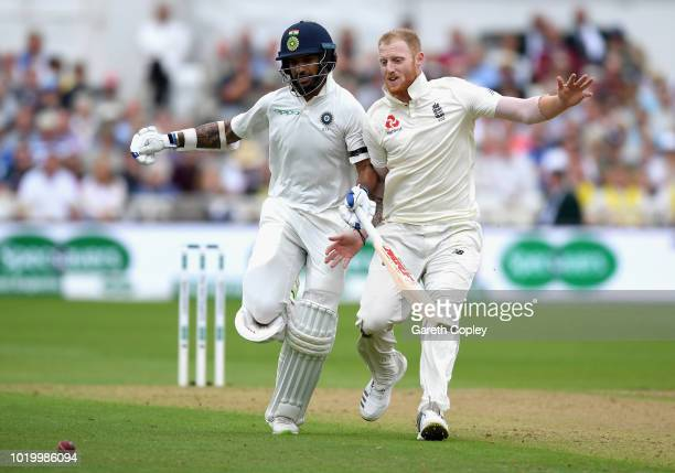 Ben Stokes of England collides with India batsman Shikhar Dhawan while trying to field the ball during the Specsavers 3rd Test match between England...
