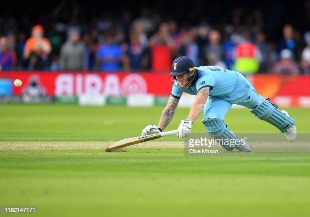 Ben Stokes of England dives to make his ground as the fielded ball hits his bat and runs away for four runs during the Final of the ICC Cricket World...