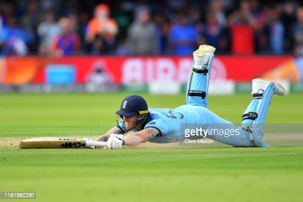 Ben Stokes of England dives to make his ground during the Final of the ICC Cricket World Cup 2019 between New Zealand and England at Lord's Cricket...
