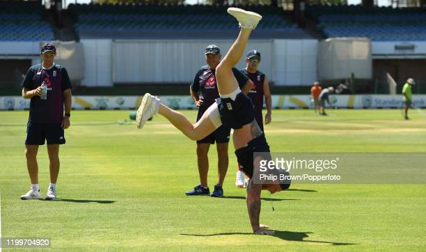 Ben Stokes of England entertains Joe Root, Chris Silverwood and Sam Curran with a handstand during a training session at St George's Park before the...