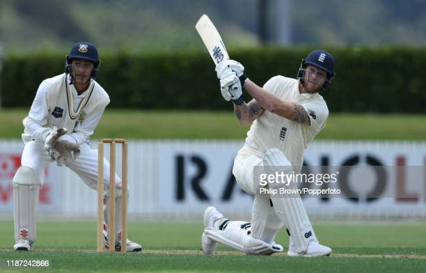 Ben Stokes of England hits a six watched by Max Chu of the New Zealand XI at Cobham Oval on November 13 2019 in Whangarei New Zealand