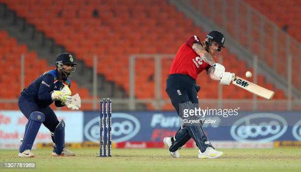Ben Stokes of England hits out for six runs watched by India wicketkeeper Rishabh Pant during the 4th T20 International between India and England at...