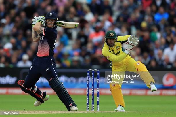 Ben Stokes of England hits the ball towards the boundary as Matthew Wade of Australia looks on during the ICC Champions Trophy match between England...