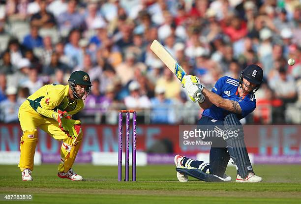 Ben Stokes of England in action batting as Matthew Wade of Australia looks on during the 3rd Royal London OneDay International match between England...