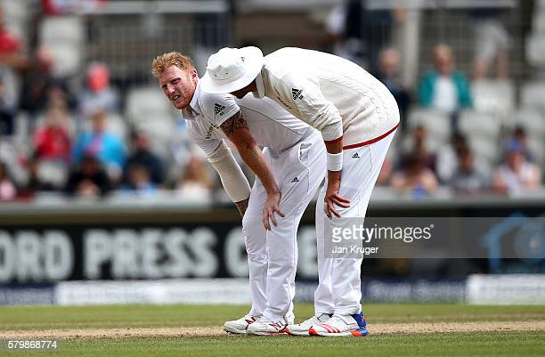 Ben Stokes of England is assisted by Stuart Broad after injuring himself during day four of the 2nd Investec Test between England and Pakistan at Old...