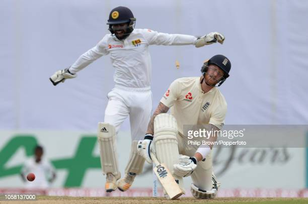 Ben Stokes of England is bowled as Niroshan Dickwella of Sri Lanka celebrates during the 1st Cricket Test Match between Sri Lanka and England at the...