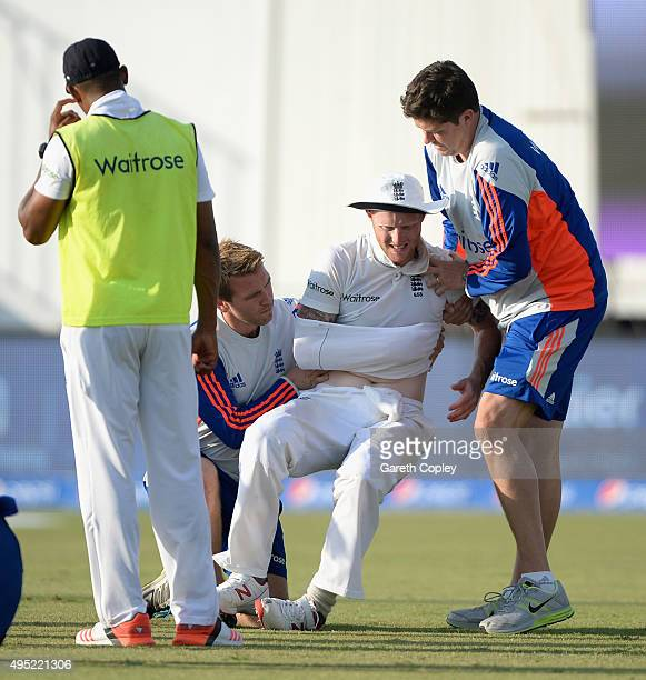 Ben Stokes of England is carried from the field after picking up a shoulder injury during day one of the 3rd Test between Pakistan and England at...