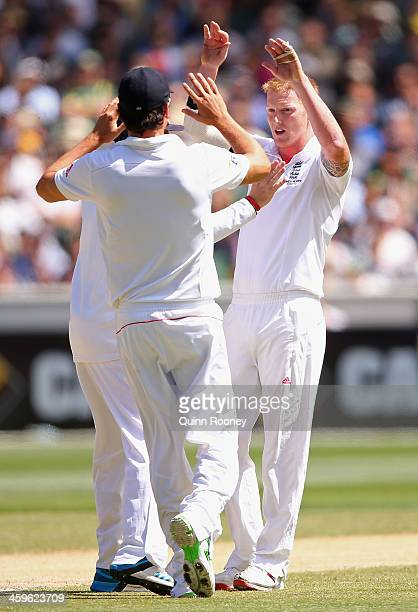 Ben Stokes of England is congratulated by team mates after getting the wicket of David Warner of Australia during day four of the Fourth Ashes Test...