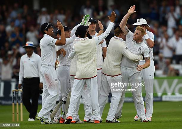 Ben Stokes of England is mobbed after taking the wicket of Peter Nevill of Australia during day two of the 4th Investec Ashes Test match between...