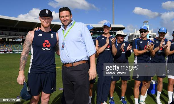 Ben Stokes of England is presented with his 50th test cap by former England fast bowler Steve Harmison during Day One of the First Test match between...