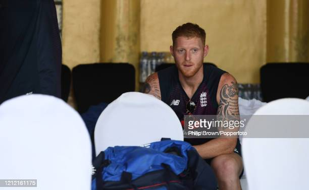 Ben Stokes of England looks on from outside a seat outside the dressing room after the Test series against Sri Lanka was postponed at P Sara Oval on...