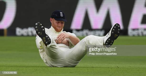 Ben Stokes of England on the ground after dropping a catch from the bat of Vernon Philander of South Africa during Day Four of the Third Test between...