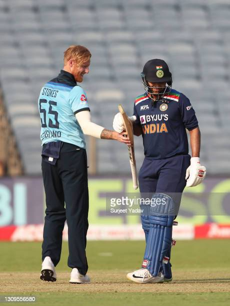 Ben Stokes of England passes the bat back to Shardul Thakur of India during the 3rd One Day International match between India and England at MCA...