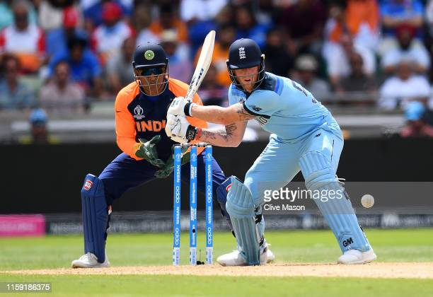 Ben Stokes of England plays a reverse sweep as MS Dhoni of India looks on during the Group Stage match of the ICC Cricket World Cup 2019 between...