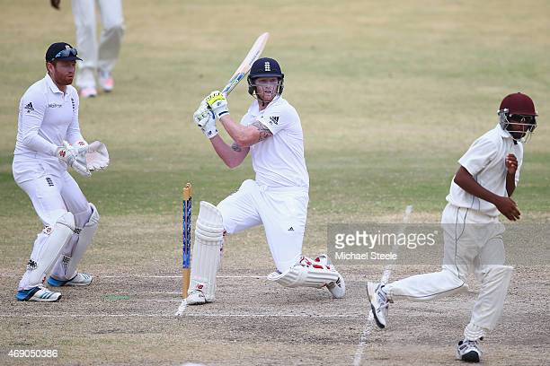 Ben Stokes of England pulls a delivery through the onside as wicketkeeper Jonny Bairstow representing St Kitts looks on during day two of the 2nd...