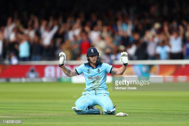 Ben Stokes of England reacts after an attempted run out results in four overthrows after riqocheting off his bat during the Final of the ICC Cricket...