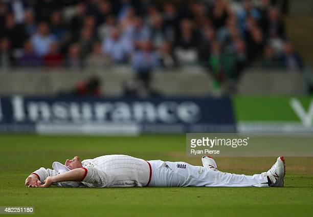 Ben Stokes of England reacts after attempting to catch Chris Rogers of Australia during day one of the 3rd Investec Ashes Test match between England...