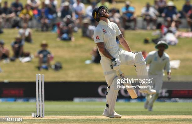 Ben Stokes of England reacts after being bowled during day five of the first Test match between New Zealand and England at Bay Oval on November 25,...