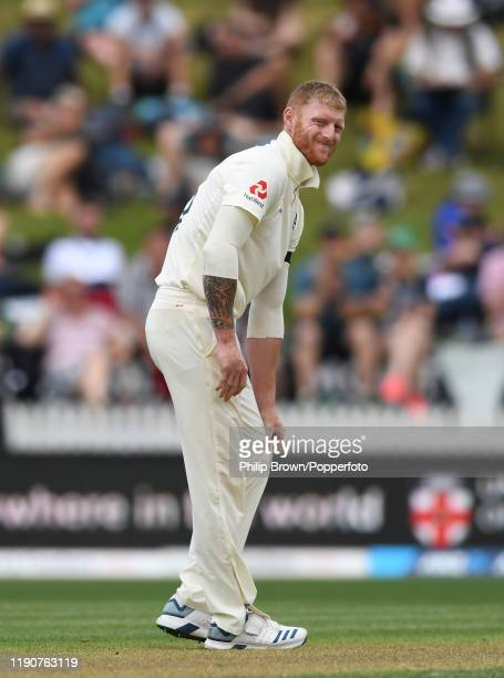 Ben Stokes of England reacts after hurting his knee during day 1 of the second Test match between New Zealand and England at Seddon Park on November...