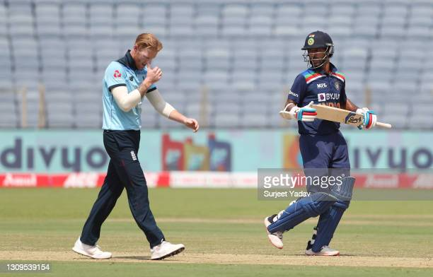 Ben Stokes of England reacts as Shikhar Dhawan of India runs between the wickets during the 3rd One Day International match between India and England...