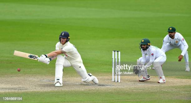 Ben Stokes of England reverse sweeps watched on by Mohammad Rizwan of Pakistan during Day Four of the 1st #RaiseTheBat Test Match between England and...