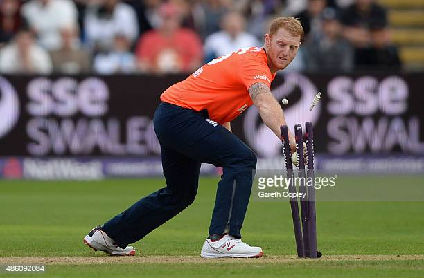 Ben Stokes of England runs out Matthew Wade of Australia during the NatWest T20 International match between England and Australia at SWALEC Stadium...