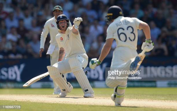 Ben Stokes of England sends Jos Buttler back before Buttler was run out by Travis Head of Australia during the third Specsavers test match between...