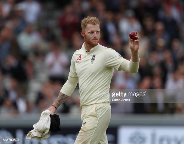 Ben Stokes of England shows the ball to spectators after taking six wickets for 22 runs during day one of the 1st Investec Test match between England...