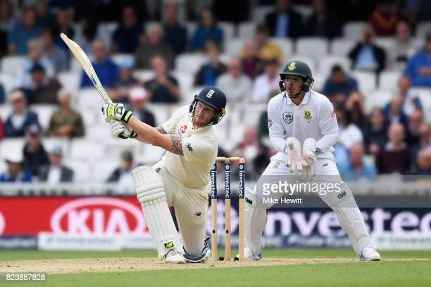 Ben Stokes of England smashes a six as Quinton De Kock of South Africa looks on during Day Two of the 3rd Investec Test match between England and...