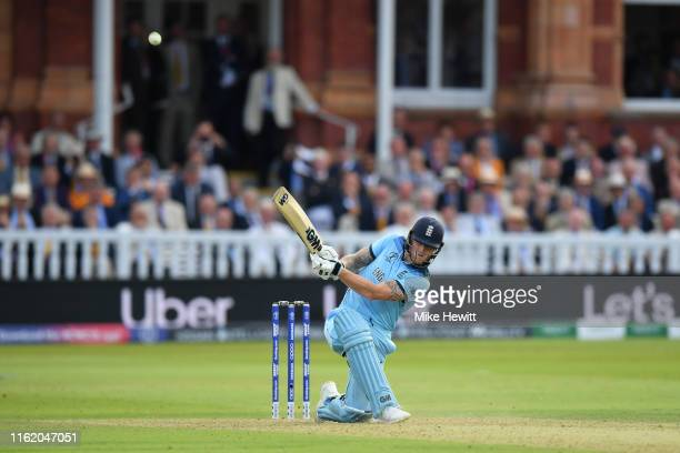 Ben Stokes of England smashes a six during the last over of the Final of the ICC Cricket World Cup 2019 between England and New Zealand at Lord's...