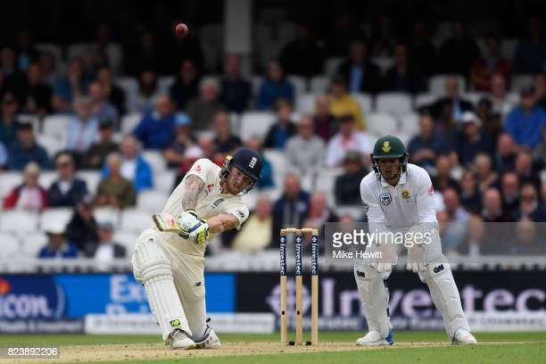 Ben Stokes of England smashes a six to bring up his century as Quinton De Kock of South Africa looks on during Day Two of the 3rd Investec Test match...