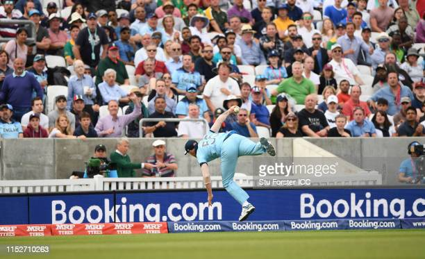 Ben Stokes of England takes a catch during the Group Stage match of the ICC Cricket World Cup 2019 between England and South Africa at The Oval on...