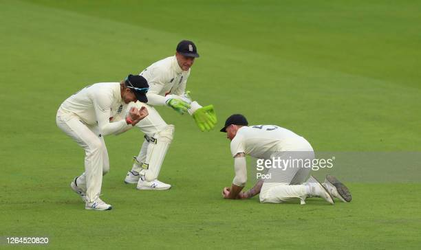 Ben Stokes of England takes the catch of Babar Azam of Pakistan as Joe Root and Jos Buttler of England celebrate during Day Three of the 1st...