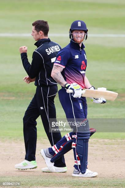 Ben Stokes of England walks off as Mitchell Santner of the Black Caps celebrates his wicket during game one in the One Day International series...