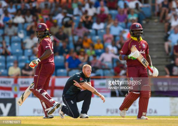 Ben Stokes of England watches as Chris Gayle and Darren Bravo of West Indies get runs during the 4th ODI between West Indies and England at Grenada...