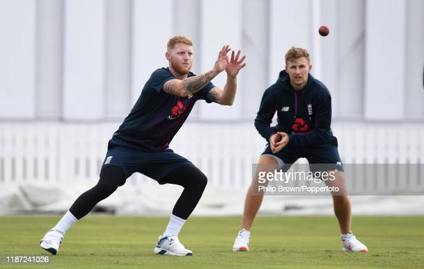Ben Stokes prepares to catch the ball watched by Joe Root of England at Cobham Oval on November 13 2019 in Whangarei New Zealand