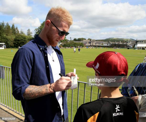 Ben Stokes signs an autograph for a fan during the PCA England Masters Day at Cockermouth Cricket Club on August 10, 2017 in Cockermouth, England.